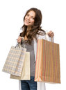 Happy girl with shopping bags half length portrait of isolated on white concept of consumerism and purchase Royalty Free Stock Photography