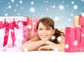 Happy girl with shopping or gift bags Stock Images