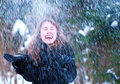 Happy girl snow portrait of a successful beautiful cute young woman lady female model playing in catching snowflakes in the winter Stock Images