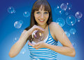 Happy girl with soap bubbles Stock Image