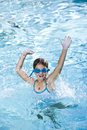 Happy girl splashing in swimming pool Stock Images