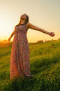 Happy girl standing on the meadow Royalty Free Stock Photo