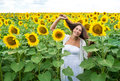 Happy girl standing in a sunflower field Royalty Free Stock Photo