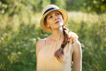 Happy girl in a straw hat stylish Royalty Free Stock Photos