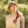 Happy girl in a straw hat stylish Royalty Free Stock Photo