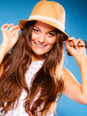 Happy girl in summer clothes and straw hat. Royalty Free Stock Photo