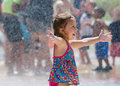 Happy girl in a summer fountain laughing child plays st joseph michigan usa Stock Image