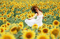 Happy girl between sunflower Royalty Free Stock Photo