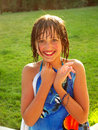 Happy girl in swim suit with blue towel Royalty Free Stock Images
