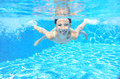 Happy girl swims in pool underwater, active kid swimming and having fun Royalty Free Stock Photo