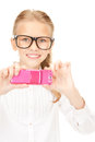 Happy girl taking picture with cell phone portrait of Royalty Free Stock Photos