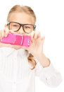 Happy girl taking picture with cell phone Royalty Free Stock Photo