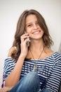 Happy girl talking on phone Royalty Free Stock Photo
