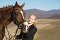 Happy girl teenager with his horse autumn Royalty Free Stock Photo