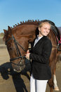 Happy girl teenager with his horse focus on the face of the Royalty Free Stock Image