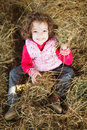 Happy Girl Throwing Hay Royalty Free Stock Photo