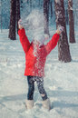Happy girl throwing snow in the air on sunny day Royalty Free Stock Photo