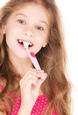 Happy girl with toothbrush picture of over white Royalty Free Stock Image