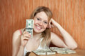 Happy  girl with US dollars  in home Stock Photo