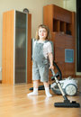 Happy girl with vacuum cleaner Royalty Free Stock Photo