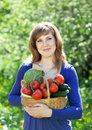 Happy girl with vegetables harvest Royalty Free Stock Photography