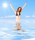 Happy girl in water under Royalty Free Stock Photo