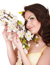 Happy girl with white spring flower and butterfly. Stock Photography