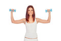 Happy girl in white toning her muscles isolated Stock Image