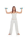 Happy girl in white toning her muscles isolated Stock Photography