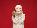 Happy girl in winter clothes blowing on palms christmas x mas people happiness concept Stock Photo