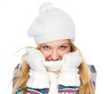 Happy girl in winter clothes hiding in scarf isolated on white Royalty Free Stock Photo