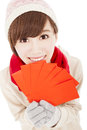 Happy girl with winter wear asian and holding red bag for chinese new year Stock Image