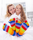 Happy girl and woman at home Royalty Free Stock Photos