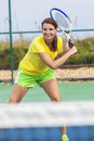Happy girl young woman playing tennis beautiful or laughing smiling and Royalty Free Stock Photo