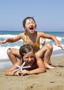 Happy girls on the beach with starfish Royalty Free Stock Images