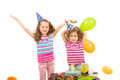 Happy girls celebrate birthday sisters of little girl with cake and balloons Royalty Free Stock Image