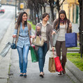 Happy girls doing shopping Stock Photos
