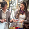 Happy girls doing shopping Royalty Free Stock Photo