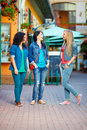 Happy girls friends walking beautiful town streets three Royalty Free Stock Photo