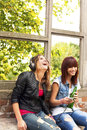 Happy girls relax with music Stock Photography
