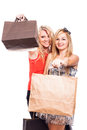 Happy girls with shopping bags two holding isolated on white background Stock Images