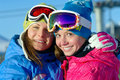 Happy girls snowboarders Stock Image