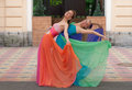 Happy girls two beautiful in colorful evening dresses Stock Photography
