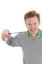 Happy golfer a young wearing a grey sweater with a green shirt holding a golf club white background Stock Photo