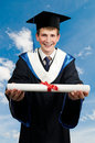 Happy graduate with diploma Royalty Free Stock Photos