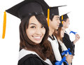 Happy graduate students isolated white background Stock Photography
