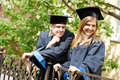 Happy graduate students outdoors Royalty Free Stock Images