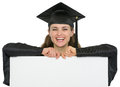 Happy graduation student girl with blank billboard Stock Photo