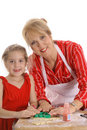 Happy grandmother and child decorating cookies Royalty Free Stock Photos