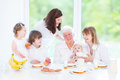 Happy grandmother enjoying breakfast with her family Royalty Free Stock Photo